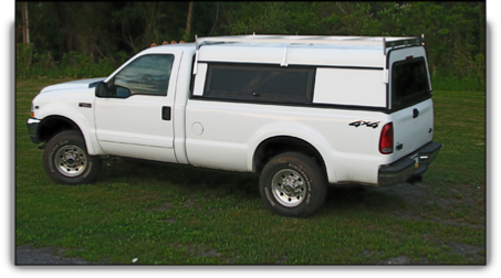 Ranger aluminum truck cap with side access doors.